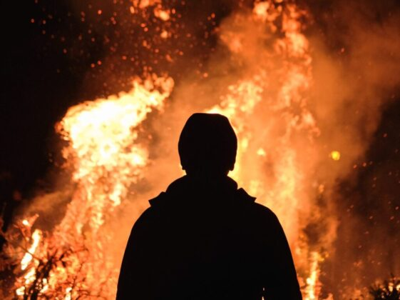 person standing in front of fire
